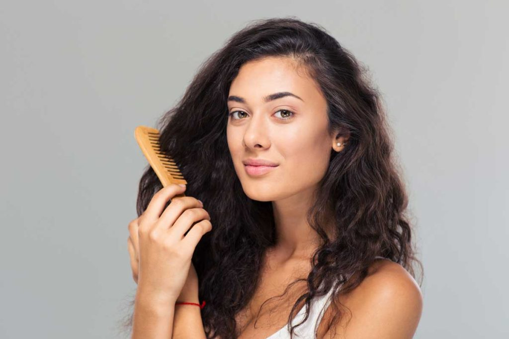 woman-combing-hair
